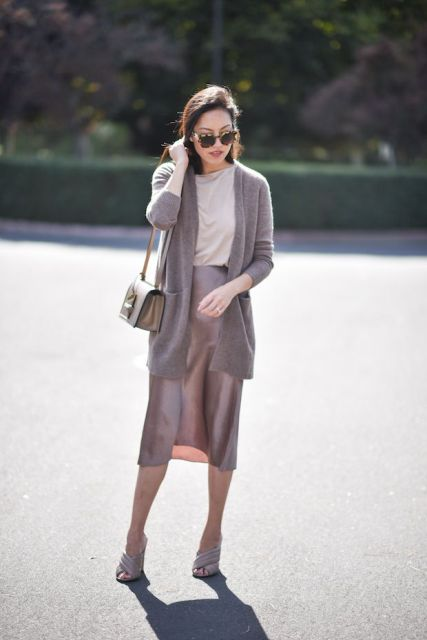 With pastel colored shirt, gray cardigan, gray bag and mules