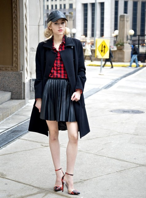 With plaid shirt, black coat, cap and high heels