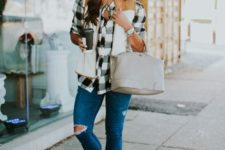 With plaid shirt, distressed jeans, beige bag and ankle boots