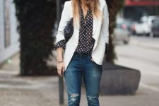 With polka dot blouse, cuffed jeans and high heels