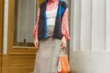 With printed blouse, white top, midi skirt, black ankle boots and printed bag