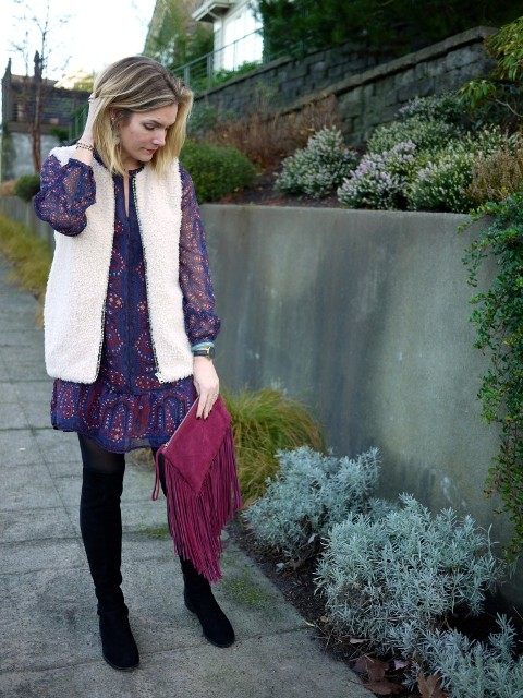 With printed dress, black high boots and purple fringe clutch