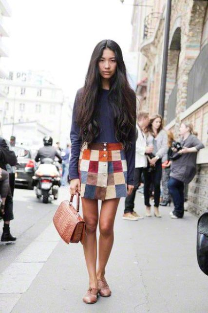 With shirt, flat shoes and brown leather bag