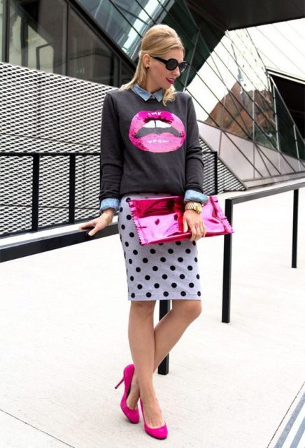 With shirt, printed sweatshirt, pink clutch and pink pumps
