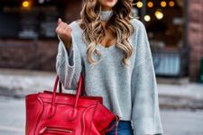 With skinny jeans, red tote bag and black over the knee boots