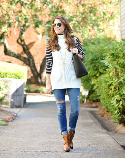 With striped shirt, distressed jeans, black tote and brown ankle boots