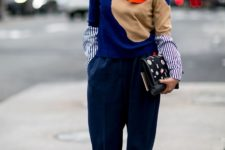 With striped shirt, embellished clutch, navy blue trousers and platform boots