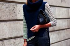 With striped shirt, leather pants and bag