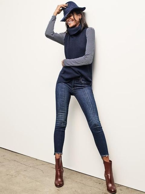 With striped shirt, navy blue hat, crop jeans and leather boots