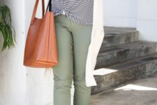 With striped t-shirt, olive green pants, flats and brown bag