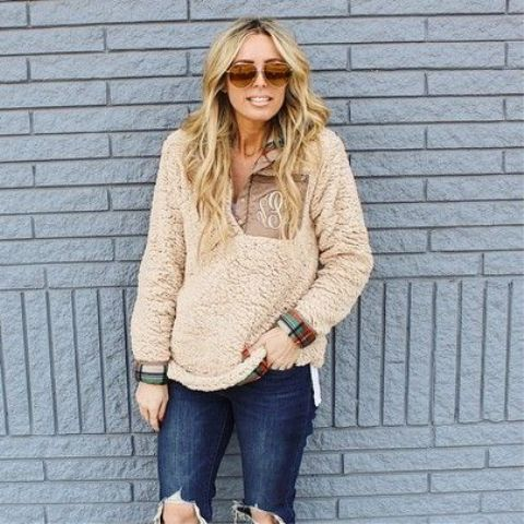 With super distressed jeans and sunglasses