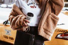 With t-shirt, black leather mini skirt and mini bag