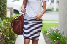 With t-shirt, brown bag and metallic shoes