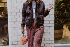 With t-shirt, small bag and puffer jacket