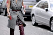 With top, printed skirt, over the knee boots and white clutch