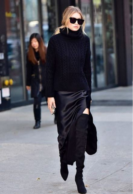 With turtleneck sweater, over the knee boots and bag
