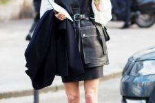 With white blouse, black mini skirt and striped shoes