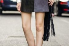 With white blouse, fringe bag and ankle boots