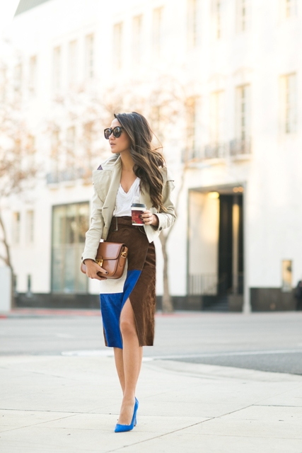 With white blouse, gray coat, blue pumps and brown bag