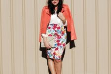 With white blouse, orange leather jacket, beige clutch and white shoes