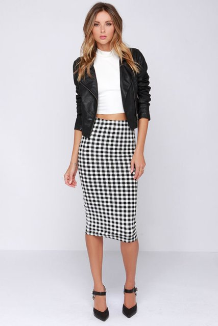 With white crop top, black jacket and black heels