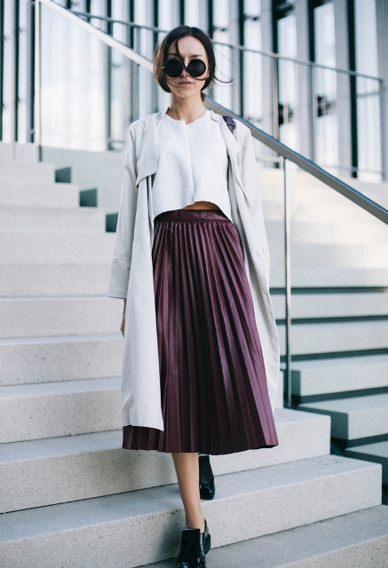 With white crop top, gray coat and black shoes