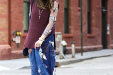 With white hat, printed maxi dress and brown boots