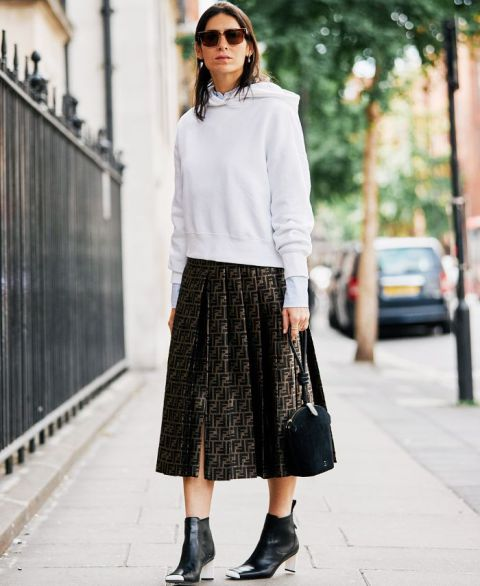 With white hoodie, small bag and ankle boots