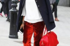 With white loose blouse, navy blue coat, red bag and animal printed flats