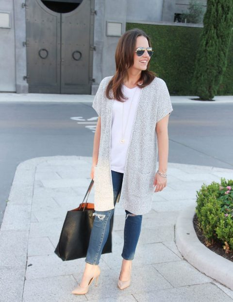 With white loose t-shirt, distressed jeans, black tote and beige pumps
