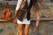 With white mini dress, brown bag and purple flats