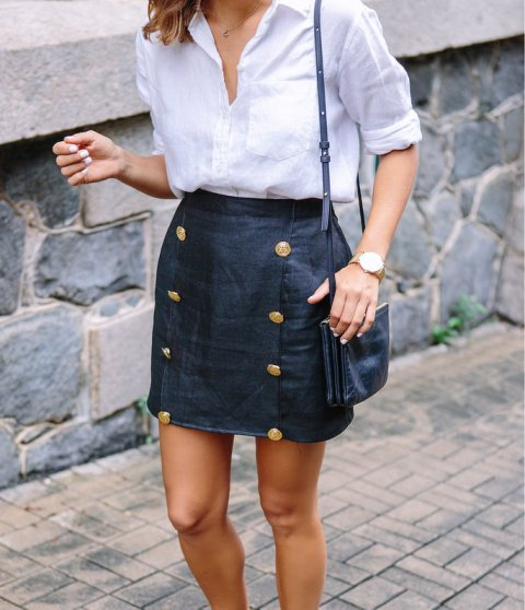 With white shirt and navy blue bag
