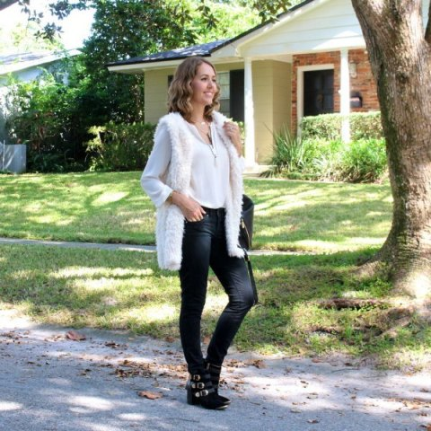 With white shirt, black bag, ankle boots and pants