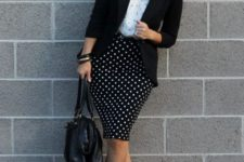 With white shirt, black blazer, black bag and shoes