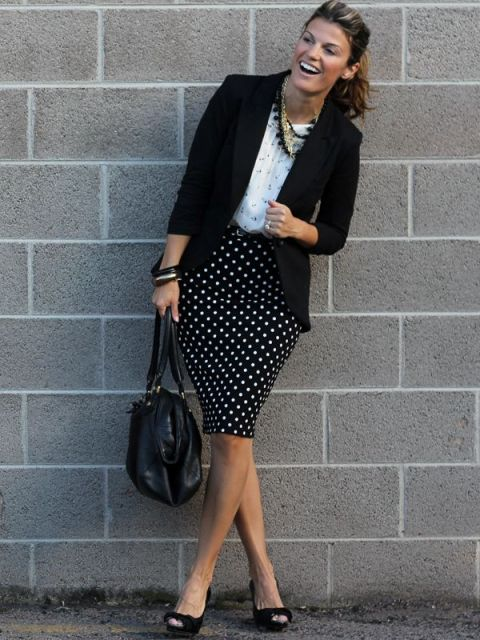 With white shirt, black blazer, black bag and shoes