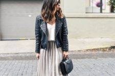 With white shirt, black leather jacket, black boots and bag