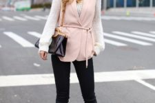 With white sweater, black pants, beige pumps and brown and black bag