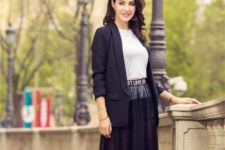 With white t-shirt and black maxi skirt
