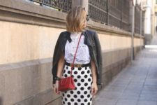 With white t-shirt, black leather jacket, red crossbody bag and red shoes