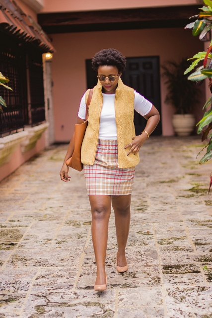 With white t-shirt, brown tote, checked mini skirt and beige shoes