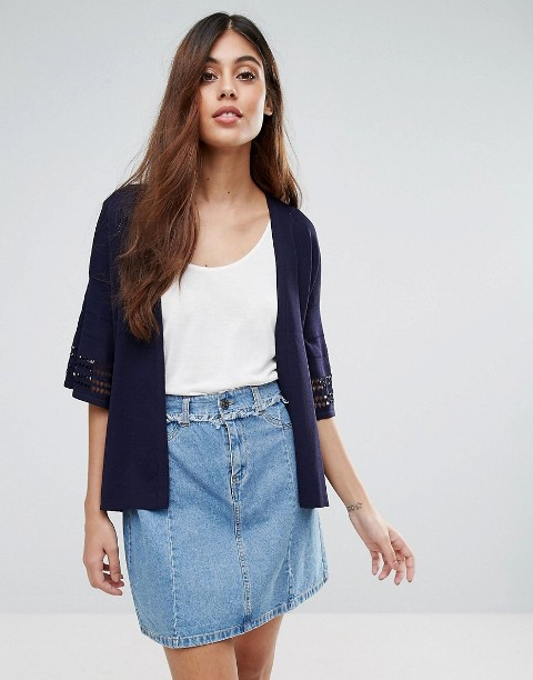 With white top and denim high-waisted skirt