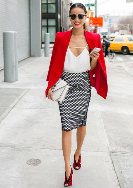 With white top, red blazer, white clutch and red high heels