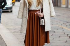 With white turtleneck, white coat, white mini bag and heels