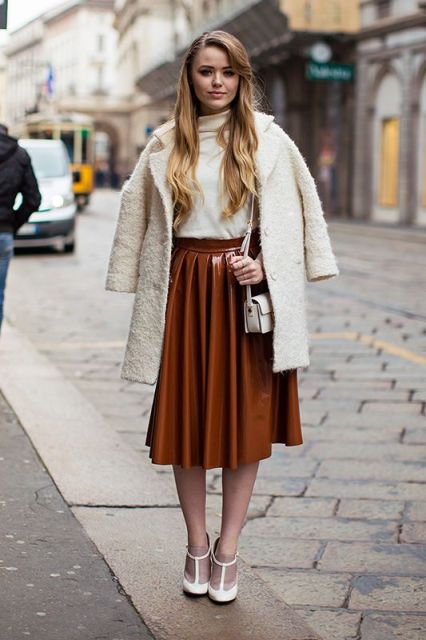 With white turtleneck, white coat, white mini bag and heels