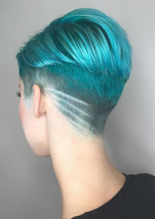 a turquoise undercut pixie with a shaved lower part and a pattern