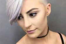 an edgy undercut long pixie hairstyle with a touch of lilac is a daring idea