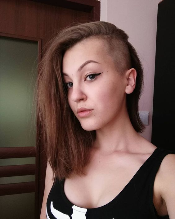 an undercut long bob haircut in chestnut is a bold idea to stand out with