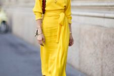 02 a bold spring look with a mid pencil skirt, a yellow long sleeve top, strappy platform shoes