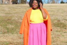 02 a color block outfit with a yellow top, a pink pleated midi, an orange coat and metallic shoes