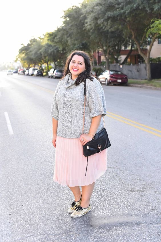 a grey slouchy sweater with short sleeves, a blush pleated skirt and glitter sneakers for a colder day